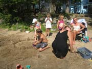 photo 1 of gallery 'Enjoying the Beach at Doe Lake'